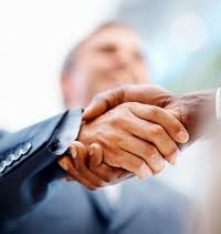 Handshake in an interview, we can see only hands, faces of the people are blur